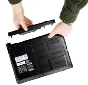 Removing a battery from a laptop. (Click for larger image.)