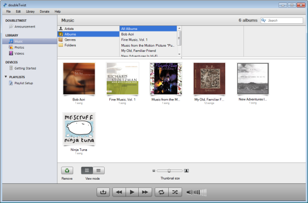 Banish Bloatware: iTunes vs. DoubleTwist; click for full-size image.